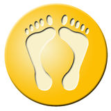 Golden button with feet Royalty Free Stock Photos