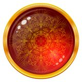 Golden button with patterned red gem Stock Images