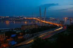 Golden cable-stayed bridge road car traffic from above. Modern Vladivostok Russia night illumination stock images
