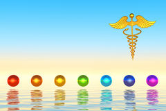 Golden Caduceus And Chakra Spheres Stock Images