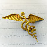 Golden Caduceus on Ecg - Ekg Paper - Medical Concept Illustratio Royalty Free Stock Photos