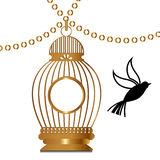 Golden cage with bird Royalty Free Stock Image