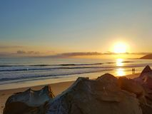 Golden California Pacific Beach Summer Sunnset. A California coast sunset at the beach on a summer evening royalty free stock image