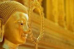 Golden calm face of Buddha statue with golden background. Have some space for text or wording about Principles royalty free stock photos