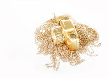 Golden camera and necklace Royalty Free Stock Photo