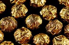 Golden candies. Stock Photos