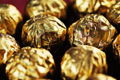 Golden candies. Royalty Free Stock Image