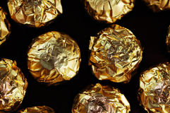 Golden candies. Royalty Free Stock Photos