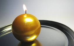 Golden candle 11. Golden candles on the grey background stock photos