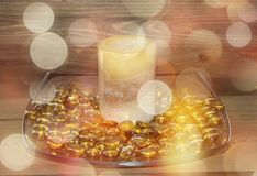 Golden candle with bokeh effects stock photography