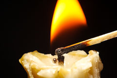 Golden candle burn on black background flame Royalty Free Stock Photography