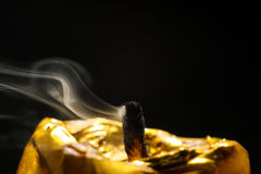 Golden candle macro dust after breath black background. Golden candle macro dust  black background Royalty Free Stock Photos