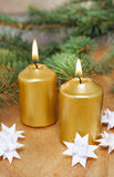 Golden candle and swedish paper stars royalty free stock photos