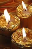 Golden candles Stock Image