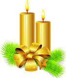 Golden candles and bow Royalty Free Stock Images