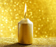 Golden candles. Gold glittering christmas lights. Blurred abstra Stock Photography