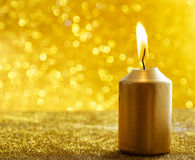 Golden candles. Gold glittering christmas lights. Blurred abstra Stock Images