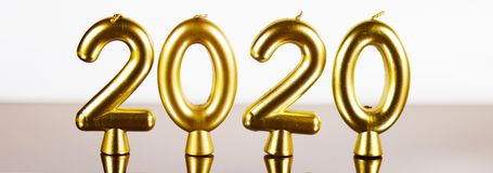 Golden candles 2020 year background stock photos
