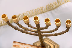 Golden candlestick. Without candles, menorah, white, blurred background royalty free stock images