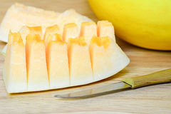 Golden cantaloupe sliced on wooden table Stock Photography