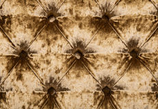 Golden capitone tufted velvet upholstery texture Stock Photography
