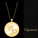 Golden Capricorn Pendant Necklace. Golden Pendant Necklace with star burst design and gold chain, with the embossed Horoscope symbol for the astrology Earth Royalty Free Stock Image