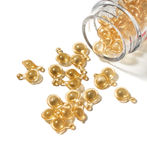 Golden capsule with cosmetic oil Stock Photo