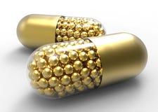 Golden capsule with gold drugs balls on white stock illustration