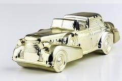 Golden Car. Golden collectable minature luxury car Stock Photo