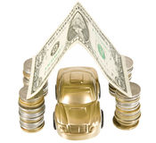 A golden car under garage roof made from banknote Stock Photo