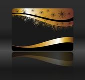 Golden card with snowflakes Stock Image