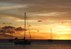 Golden Caribbean Sunset Cruise Stock Photo