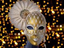 Golden carnival mask. On shiny black background Royalty Free Stock Photo