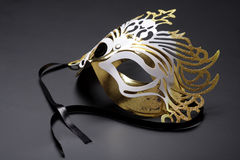 Golden carnival mask. Golden carnival mask on a grey background Stock Photography