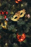 Golden carnival mask like a Christmas tree toy royalty free stock images