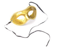Golden carnival mask with ribbons Stock Photos
