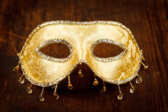 Golden carnival mask on the table Royalty Free Stock Photography