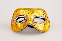 Beautiful golden carnival mask whit ribbon Stock Photo