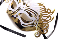 Golden carnival mask on white background. Stock Photos