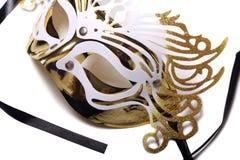 Golden carnival mask on white background. Golden carnival mask on a white background Stock Photos