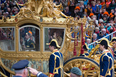 Golden carriage. THE HAGUE, HOLLAND - SEPT 17: The golden carriage with Queen  Maxima and King Willem-Alexander on Prinsjesdag (opening of parliamentary year by Royalty Free Stock Image