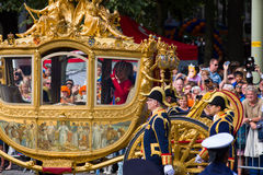 Golden carriage. THE HAGUE, HOLLAND - SEPT 16: The golden carriage with Queen  Maxima and King Willem-Alexander waving to the crowds on the bicentennial Stock Photography
