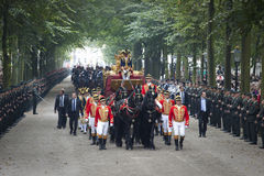 Golden carriage with queen beatrix. THE HAGUE, HOLLAND - SEPT 21: The golden carriage with Queen Beatrix and royal Princess Maxima on Prinsjesdag (opening of Stock Image