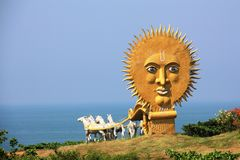 Golden carriage with  white horses in the temple complex Murudeshwar, carrying to the sea with a huge sun Royalty Free Stock Photography