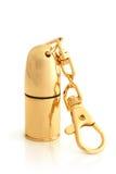 Golden cartridge trinket Stock Image
