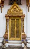 Golden carving wooden door. Royalty Free Stock Photo