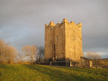 Golden castle. A medieval castle in Ireland is bathed in the golden glow of sunset Stock Photography