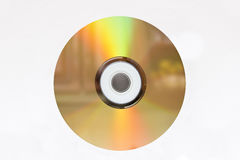 Golden CD. Colored surface of cd against white background Stock Photo