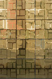 Golden ceramic tiles. Shiny golden ceramic tiles with a design pattern Stock Images