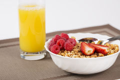 Golden cereals with berrie halfs and juice Royalty Free Stock Photography